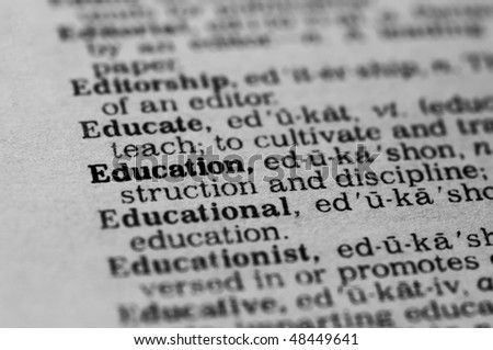 Extreme close up of the word EDUCATION found inside a dictionary - stock photo