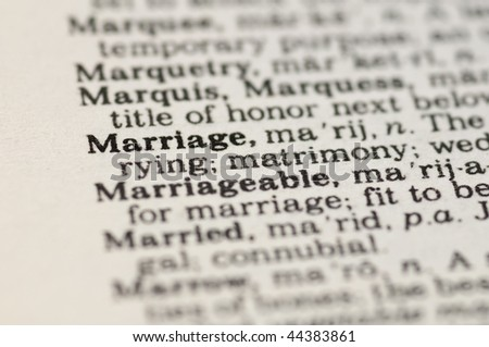 Extreme close up of the word MARRIAGE found inside a dictionary - stock photo