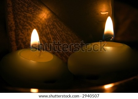 Extreme close up of two burning candle