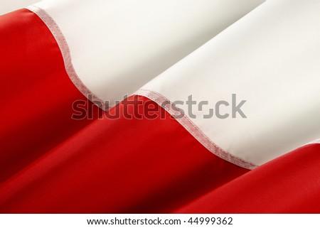 Extreme close up of wavy Polish flag - stock photo