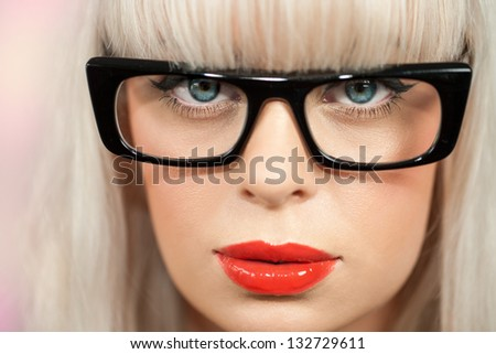 extreme close up of woman with retro black plastic glasses. - stock photo