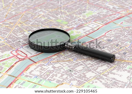 Extreme Closeup Magnifying Glass over the Map - stock photo