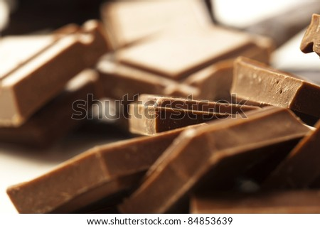 extreme closeup of a chocolate pieces stack - stock photo