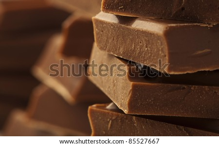 extreme closeup of a chocolate pieces tower - stock photo