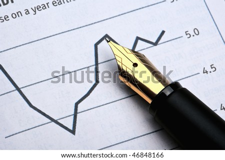 extreme closeup of a fountain pen and charts