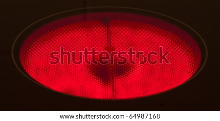 extreme closeup of a hot hob ready for cooking - stock photo