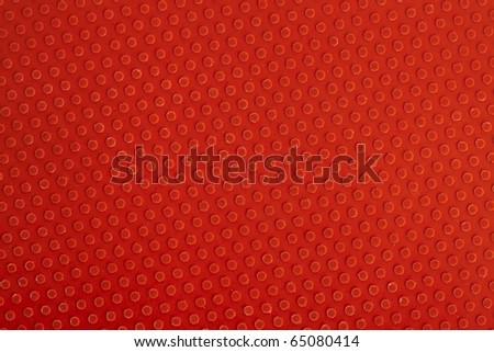 extreme closeup of a ping pong racket red part - stock photo