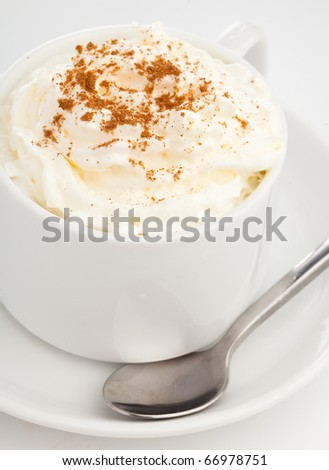 extreme closeup of a recently made capuccino - stock photo