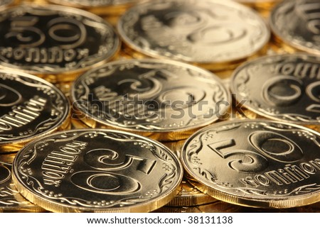 Extreme closeup of a shiny golden coins, background