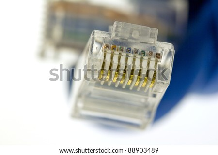 extreme closeup of an Ethernet plug and cable
