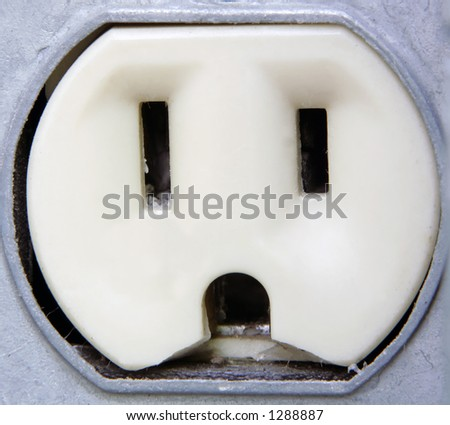 Extreme Closeup of an outdoor metal electrical outlet. - stock photo