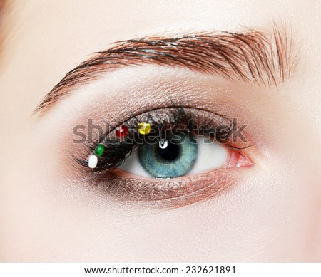 extreme closeup of beautiful womanish eye with glamorous makeup macro