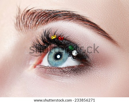 extreme closeup of beautiful womanish eye with glamorous makeup macro - stock photo