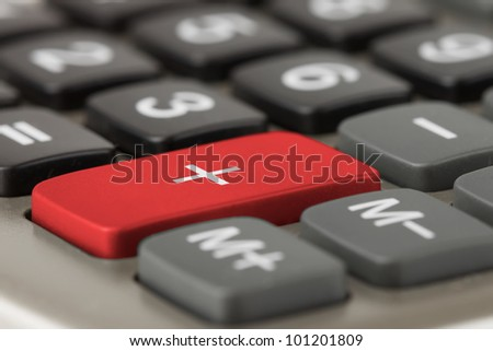 Extreme Closeup of calculator plus red button - stock photo