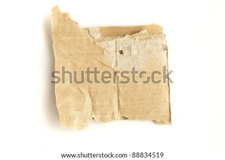 extreme closeup of cardboard piece on a white background