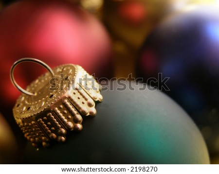 Extreme closeup of Christmas ornaments detailing the ornamental hooks. - stock photo