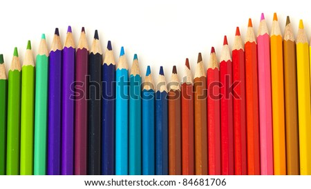 extreme closeup of crayons wave on white background - stock photo