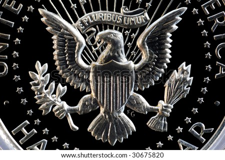 Extreme closeup of eagle and e pluribus unum motto on the back of a US Silver Half Dollar - stock photo