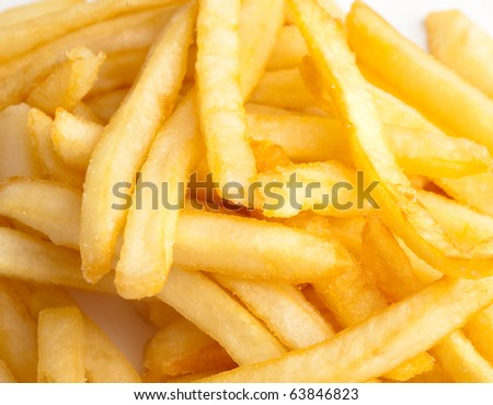 extreme closeup of fried potatoes on white background - stock photo