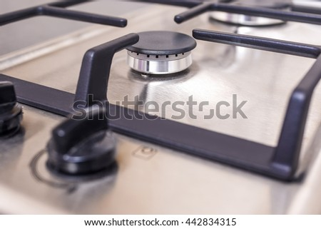 Extreme Closeup of Modern Double Burners Split Gas Oven. Horizontal Image Orientation