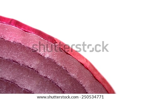 Extreme closeup of red onion showing flesh and skin on white background - stock photo