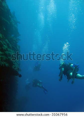 Extreme deep diving along the wall - stock photo