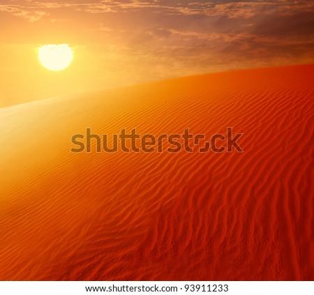 Extreme desert landscape with orange sunset, beautiful sandy background with hot sunlight, wilderness, beauty of nature, United Arab Emirates, Dubai - stock photo