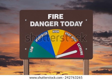 Extreme fire danger today sign with orange sunrise. - stock photo