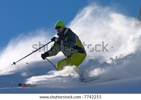 extreme freeride skier moving down on ski slope