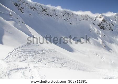 Extreme Freeride, tracks on a mountain slope. - stock photo