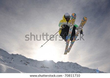 extreme freestyle ski jump with young man at mountain in snow park at winter season - stock photo