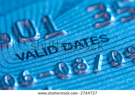 "Extreme Macro of a Credit Card. Detail: ""Valid Dates"". Cool blue light."