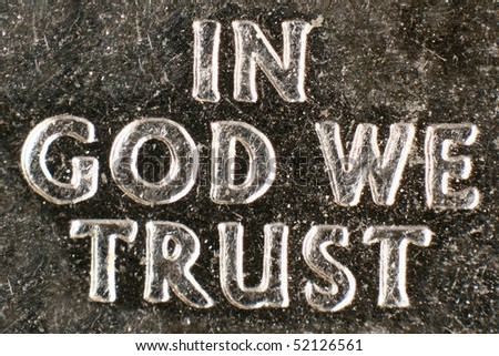 Extreme macro of a current US coin's religious motto. - stock photo