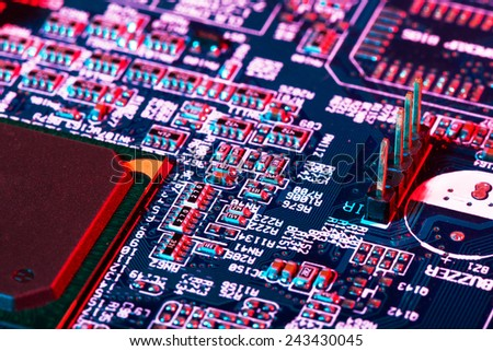 Extreme macro of electric components on printed circuit board - stock photo