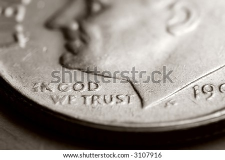 "Extreme magnification macro  photo of a US dime, with the focus on ""In God We Trust""."