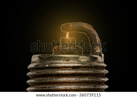 Extreme magnification - Spark plug firing - stock photo