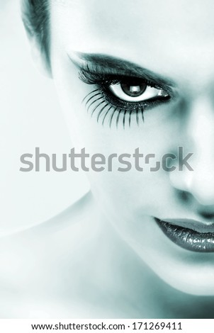Extreme makeup. Beautiful half face,black and white - stock photo