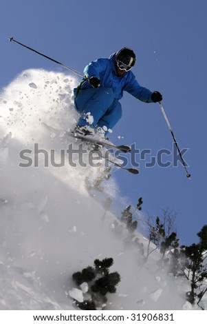 Extreme skier jumping  against the blue sky.