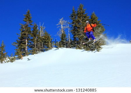 Extreme skier jumping in the Utah mountains, USA. - stock photo