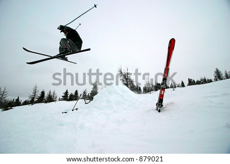 Extreme Skiing (some motion blur)  Looks really neat with a Sumi-e filter on it. - stock photo