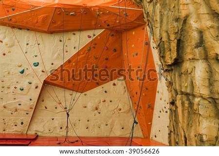 Extreme sport climbing up mountain rock build wall - stock photo
