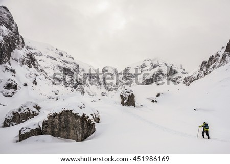 Extreme Sport. Lone hikers in winter in romanian carpathian mountains - stock photo