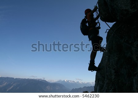 Extreme sport - silhouette of a climber - stock photo