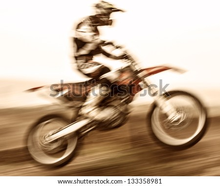 Extreme sport, slow motion on motorbike, pro race driver jumping on the dirt bike, motocross, speed and challenge concept - stock photo