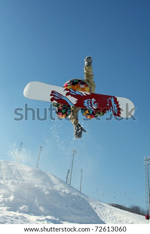 Extreme sports: snowboarder flying in air - stock photo