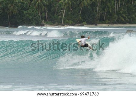 Extreme sports surfer in paradise - stock photo