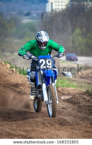 Extreme sports - the driver of the motorcycle offroad - stock photo