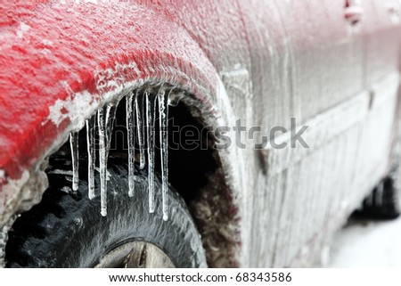 Extreme winter series. Car in ice. Icicles on a wheel arch close-up. - stock photo