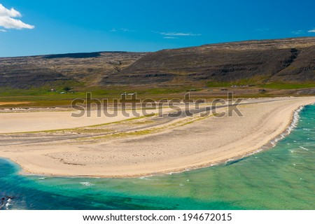 Extremely beautiful bay with mighty golden beaches and turquoise sea in the West Fjords, Iceland. Panoramic photo - stock photo