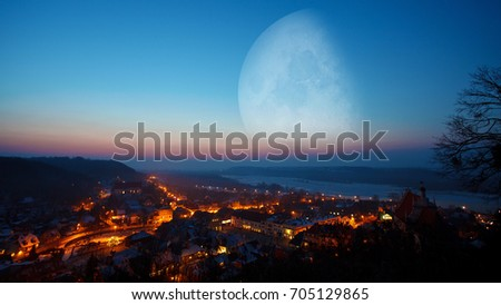 Extremely big moon over the city, Kazimierz Dolny by Vistula River, Poland